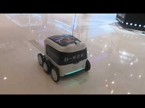 Машина-робот и торговый автомат в одном_ ездит в торговом центре